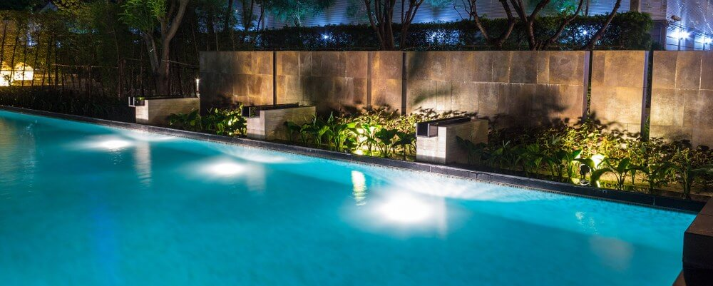 Simple and clean pool landscaping by night